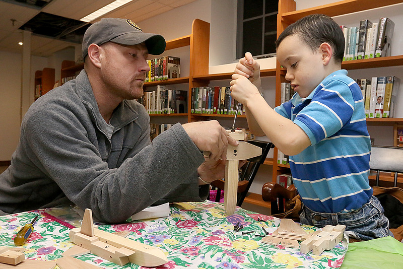 Christian Rood, 7, of Ashburnham work on building and painting a wooded plane with the help of instructor Robert Leduc of Wooden Toys and Crafts at the Stevens Memorial Library in Ashburnham. SENTINEL & ENTERPRISE/JOHN LOVE