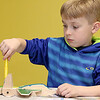 Chase McGillibary, 5, works on building and painting a wooded plane at a program put on by instructor Robert Leduc of Wooden Toys and Crafts at the Stevens Memorial Library in Ashburnham. SENTINEL & ENTERPRISE/JOHN LOVE