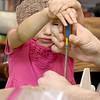 Liberty Rood, 3, and her dad Mark Rood work on building and painting a wooded plane at a program put on by Robert Leduc of Wooden Toys and Crafts at the Stevens Memorial Library in Ashburnham. SENTINEL & ENTERPRISE/JOHN LOVE