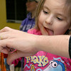Hazel Morrison, 3, and her dad lazarus Morrison of Ashburnham works on building and painting at a program with instructor Robert Leduc of Wooden Toys and Crafts at the Stevens Memorial Library in Ashburnham. SENTINEL & ENTERPRISE/JOHN LOVE