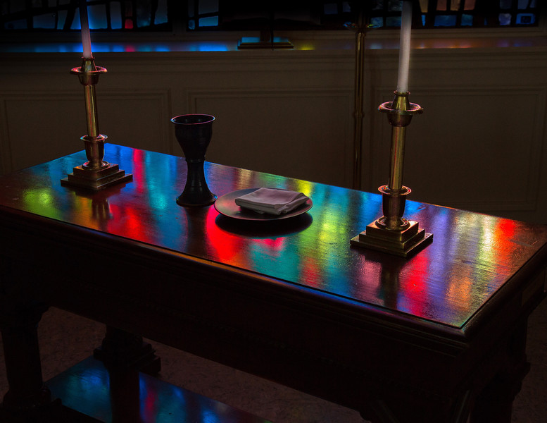 Communion table with stained glass lighting effects