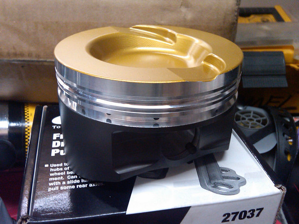 4.3500 diameter custom Diamond pistons.  8.5:1 compression, ceramic top coating, black on the sides is teflon