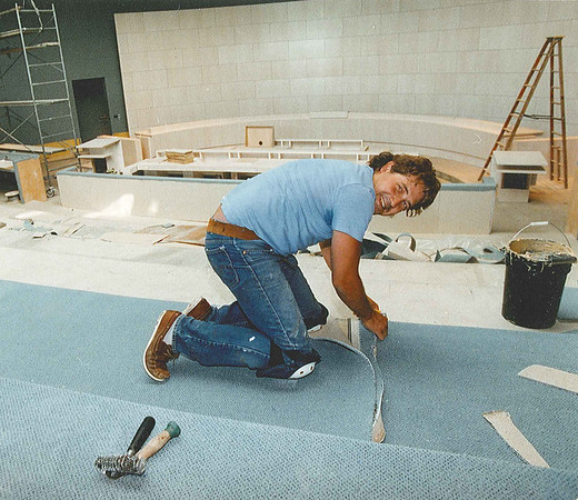 City Hall Construction - workers are putting the finishing touches on Edmonton's new city hall in preparation for Sunday's official opening.  Brent Jobb lays carpeting in the new council chambers.