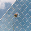 He Does Windows – it's an acrobatic job that Ken Player has tackled Tuesday, to say nothing of a never-ending one.  The intrepid glass-cleaner is caught hard at work on the pyramid at city hall