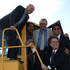 Mayor Stephen Mandel, Councillor Amarjeet Sohi, Gene Zwozdesky, Minister of Health of Wellness, Carl Benito, MLA for Edmonton Millwoods and Brent McDonough, Chair, Edmonton Public Library Board of Trustees pose on equipment at the construction site of The Meadows Community Recreation Centre and Meadows Library and the Meadows District Park.