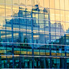 A reflection of a building in the windows of the Salt Lake City Library, Salt Lake City, UT