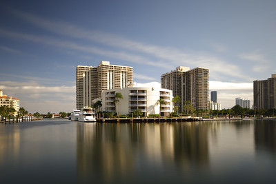 Long exposure image of luxury condos and yachts at Aventura FL, USA