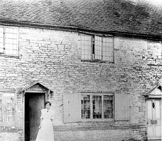 <center><font size=3><u> - Old Brick House - </u></font> (BS0394)  Woman standing in the doorway. </center>