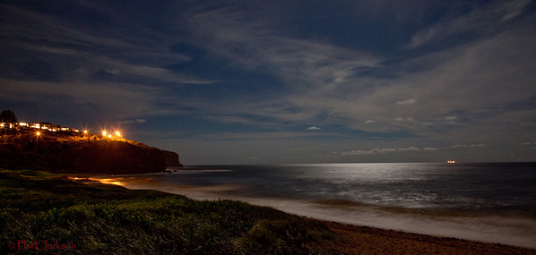 Newport Beach headland under full moon with ship on horizon. 2009.