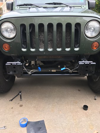 Popped the bumper off and added a few coats of paint to the frame. After removing the electronic sway bar system too.