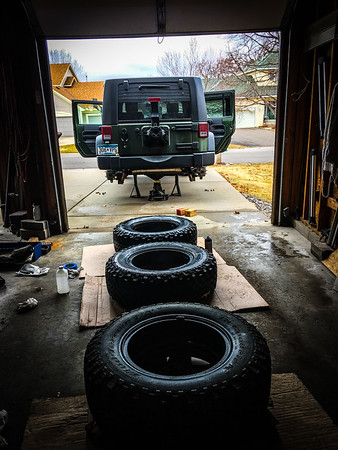 I sprayed them with the tires still on, since I was planning on getting new tires with my new wheel set.