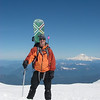 Erik at summit of Mt Adams with Mt Rainier in background.