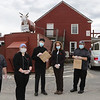 Bull Run Restaurant owner Alison Tocci of Shirley, 4th from left, and employees, outside the restaurant. They are coping with the Covid-19 emergency by doing takeout meals. From left: Keith Forest of Fitchburg, Tocci's niece Kate Sawyer of Shirley, Walter Collins of Pepperell, Tocci, executive chef Stephen Barck of Shirley, and Tocci's nephew, general manager Bryan Sawyer of Shirley.   (SUN/Julia Malakie)