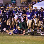 Connor Carrico (1) was knocked out of bounds on the Male sideline.