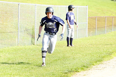 Saxonburg's #17 rounds third base on his way to home in Tuesday's game against Karns City. Seb Foltz/Butler Eagle