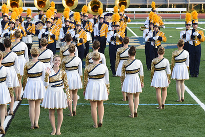 Harold Aughton/Butler Eagle: Senior Leah Coeispot, co-captain of the Butler High School Sequinettes Dance Team, waves to the crown as she was recognized during the half-time show.