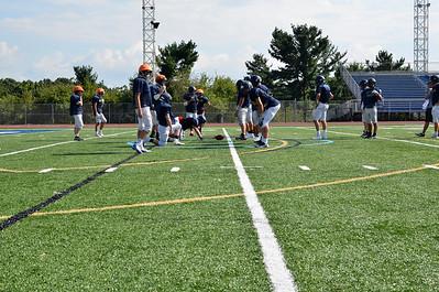 Butler's varsity football team practices on Art Bernardi Stadium's new turf Wednesday afternoon. Tanner Cole/Butler Eagle