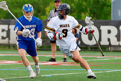 Chris Sicher (9) works past Hampton's Joshua Andersson in the Planets WPIAL championship game. Seb Foltz/Butler Eagle
