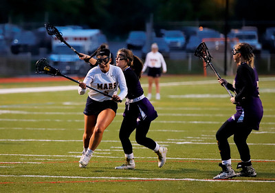 Mars senior Gianna Buzzelli pushes past a plum defender in Monday night's playoff win. Seb Foltz/Butler Eagle