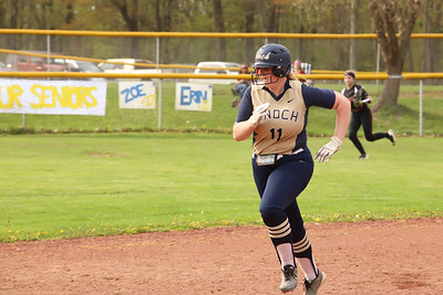 Knoch #11 eyes the ball on her way to third base against New Castle. Seb Foltz/Butler Eagle