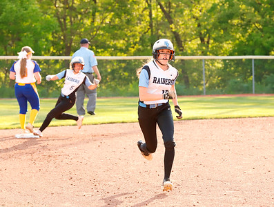 Kearson Wagner heads to third on her way home with Mackenzie Baker in hot pursuit. Seb Foltz/Butler Eagle