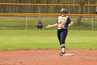 Knoch's #11 responds to teammates encouraging her to go for third base after reaching second. Seb Foltz/Butler Eagle