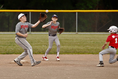 With Chet Harsch backing him up, Nolan Erickson of the Mars Diamondbacks makes a play at second base catching a Mars Red Sox base runner trying to steal in Wednesday night's 9-10 year old matchup. Seb Foltz/Butler Eagle