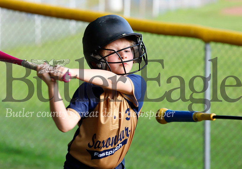 Kinzey Ziacik of the Saxonburg 10u fastpitch softball league keeps her eye on the target, getting in some warmup swings prior to batting against Freeport Friday evening at Laura J Doerr Memorial Park. Seb Foltz/Butler Eagle