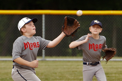 Backed up  by Chet Erickson, Nolan Erickson of the Mars Diamondbacks makes a play at second base, catching a Mars Red Sox base runner trying to steal in Wednesday night's 9-10 year old matchup. Seb Foltz/Butler Eagle