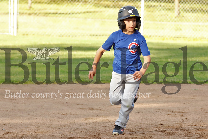 Zane Rupert charges toward third base in the Saxonburg 7-8 year-old little league championship game between the Cubs and the Cardinals. The Cardinals went on to win 13-4.  Seb Foltz/Butler Eagle