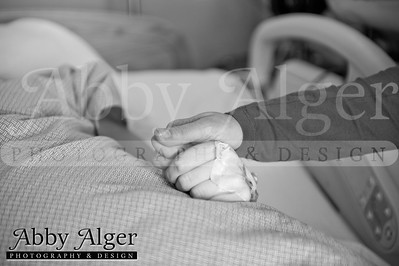 adoption, birth of a baby being placed for adoption, adoptive dad cutting cord of adopted baby, birth mom giving birth in hosptial, half african american newborn, baby girl, newborn baby girl, spring baby, Abby Alger Photography, birth photography