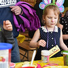Sophia Contois, 5, of Fitchburg decorates cupcakes at the annual Bunny Breakfast on Saturday at Reingold Elementary School in Fitchburg.  SENTINEL & ENTERPRISE JEFF PORTER