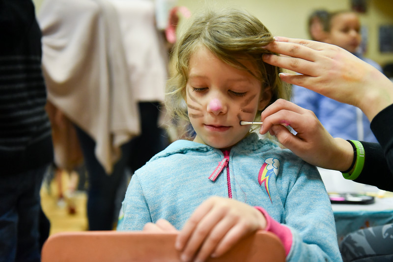 6 year old Aria get's whiskers drawn on her cheek to compliment a set of bunny ears at the annual Bunny Breakfast on Saturday at Reingold Elementary School in Fitchburg.  SENTINEL & ENTERPRISE JEFF PORTER