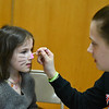 Julia, 5, get's her face painted by volunteer Sarah Primeau, 15, of Fitchburg at the annual Bunny Breakfast on Saturday at Reingold Elementary School in Fitchburg.  SENTINEL & ENTERPRISE JEFF PORTER