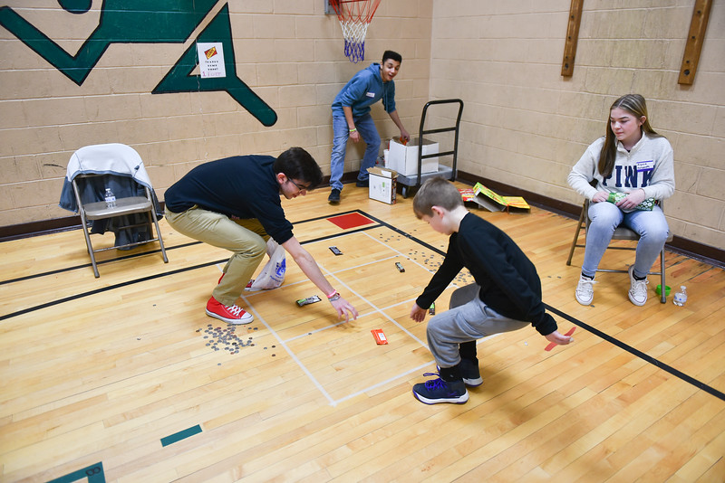Fitchburg High School volunteers run games at the annual Bunny Breakfast on Saturday at Reingold Elementary School in Fitchburg.  SENTINEL & ENTERPRISE JEFF PORTER