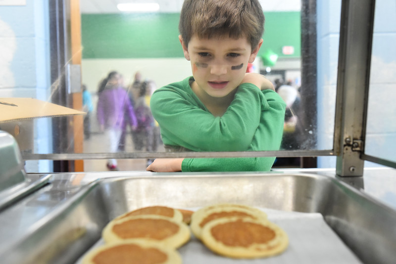 Alex Primeau, 6, of Reingold Elementary looks at the final batch of pancakes at the annual Bunny Breakfast on Saturday at Reingold Elementary School in Fitchburg.  SENTINEL & ENTERPRISE JEFF PORTER