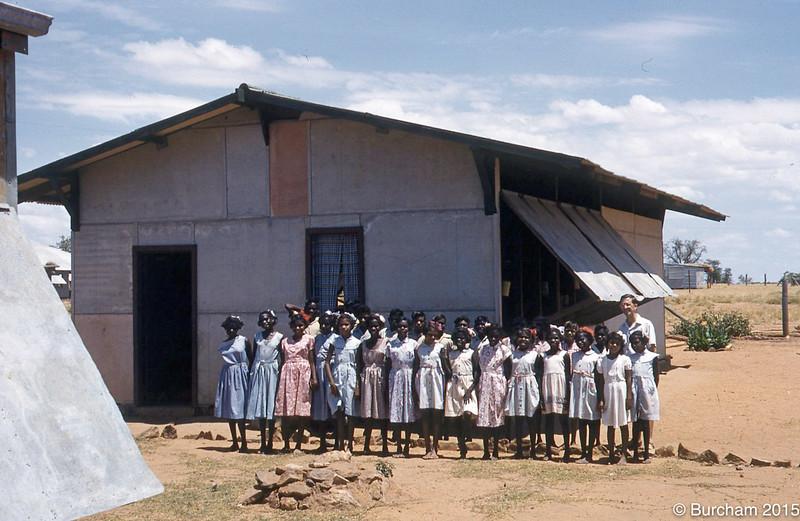 1956 Ciryl Burcham and his class, first Fitzroy Crossing School.