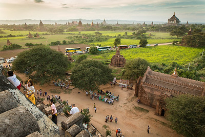A lot of tourist climbing up on a temple to see the sunset in Bagan