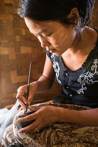 Woman making local handicrafts