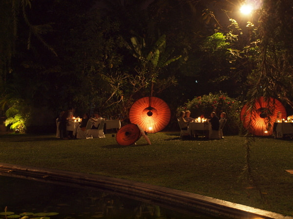 Evening dinner on the lawn with lighted Burmese umbrellas, Governor's Residence hotel, Yangon