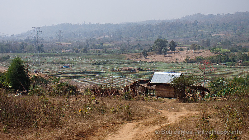 Farmland spreads out from Hsipaw village's northern border to the hills and waterfall beyond