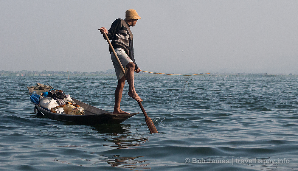 An Intha fisherman, paddling his boat with his foot