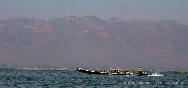 A tourist tour boat speeds out from Nyaungshwe to Inle Lake