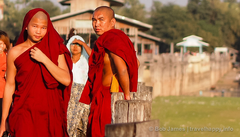 Two young monks make their way across Amarapura's U Bein Bridge