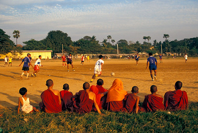 Buddhist Monks watch Football