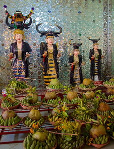Nat Shrine Statues and Food Offerings