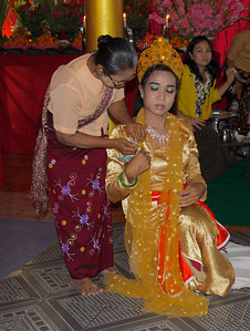 Woman Pinning Money on Dancer