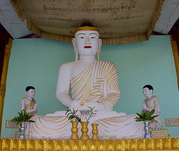 White Buddha and Monk Statues