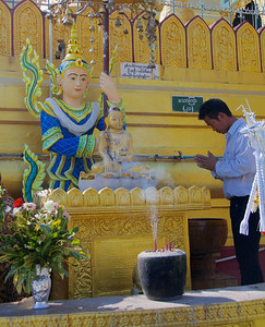 Man Praying at a Shrine