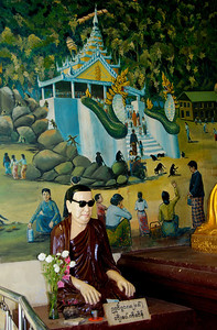 Buddhist Monk Statue with Mural